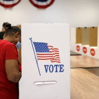 A voter fills out her ballot during early voting at the Oklahoma County Election Board in Oklahoma City, Friday, June 26, 2020. [Bryan Terry/The...
