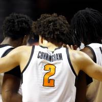 Oklahoma State's Cade Cunningham (2) huddles with teammates in the first half during the men's college basketball game between the Oklahoma State...