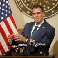 Gov. Kevin Stitt speaks about PPE assistance for Oklahoma schools for in-person instruction during a press conference at the State Capitol in...