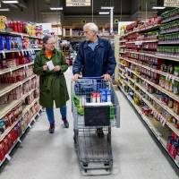 Customers Lynda and Terry Witty shop for groceries Thursday morning at the Homeland store at 2400 S Cornwell in Yukon. Homeland stores have...