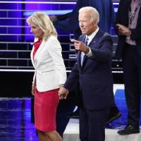 <strong>Former Vice President Joe Biden leaves the stage with his wife Jill after the conclusion of the second night of the first Democratic presidential candidates debate in Miami, Florida, U.S. June 27, 2019. [REUTERS/Mike Segar]</strong>