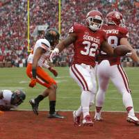 Oklahoma's Samaje Perine (32) scores a touchdown in the first quarter of a Bedlam college football game between the University of Oklahoma Sooners (OU) and the Oklahoma State Cowboys (OSU) at Gaylord Family-Oklahoma Memorial Stadium in Norman, Okla., Saturday, Dec. 6, 2014. Photo by Bryan Terry, The Oklahoman