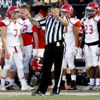 Corey Miller, pictured here officiating the Class 5A state championship game, had quite the Saturday on Dec. 7. Not long before officiting the...