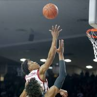 Oklahoma's Kristian Doolittle (21) puts up a shot beside Baylor's Freddie Gillespie (33) during a men's NCAA basketball game between the University...