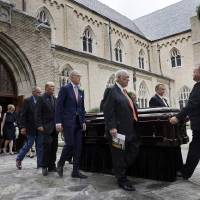 Pallbearers walk the casket bearing T. Boone Pickens from the Highland Park United Methodist Church following his funeral service Thursday in...