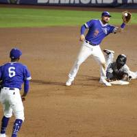 Jake Peter catches the ball as an opponent slides into second base during the Oklahoma City Dodgers game against the New Orleans Baby Cakes June...