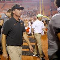 Oklahoma State football coach Mike Gundy is not worried about the air conditioning in the visitor's locker room at Texas. [Sarah Phipps/The...
