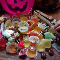 Kyla McDonnell, 4, daughter of Features Writer Brandy McDonnell, selects a Malaysian jelly from an assortment of international candies Instead of...