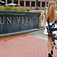 Kaitlin Bennett poses with an AR-10 rifle and graduation cap after the 2018 commencement ceremony at Kent State University on May 12, 2018. [Justin...