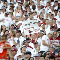 Oklahoma fans cheer during a college football game between the University of Oklahoma Sooners (OU) and the Houston Cougars at Gaylord...
