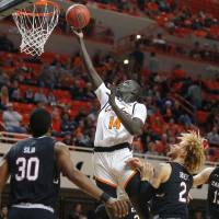 Oklahoma State's Yor Anei (14) goes to the basket as South Carolina's Chris Silva (30), Hassani Gravett (2) and Felipe Haase (13) watch during a...