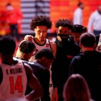 Oklahoma State's Cade Cunningham, center, is regarded as a rare point guard with his 6-foot-8, 220-pound frame. [Sarah Phipps/The Oklahoman]