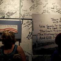 Photo - Visitors tour the Oklahoma City National Memorial & Museum. Photo by Bryan Terry, The Oklahoman archives