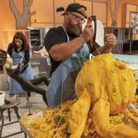 """Team Mummies Rejects Pumpkin Carver Daniel Miller, who hails from Wilson, Oklahoma, sculpts a giant octopus head during Episode 4 of """"Halloween..."""