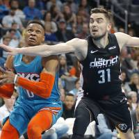 Oklahoma City's Russell Westbrook (0) os fouled by Washington's Tomas Satoransky (31) during an NBA basketball game between the Oklahoma City...