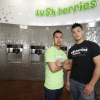 Photo - Owner Truong Le, left, and business partner Vu Nguyen at Lush Berries in Yukon. PHOTO BY STEVE GOOCH, THE OKLAHOMAN