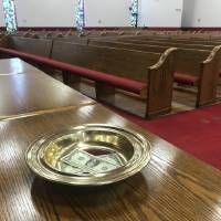 An offering plate is shown at St. John Missionary Baptist Church in Oklahoma City. [Carla Hinton/The Oklahoman]