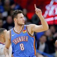 Oklahoma City's Danilo Gallinari reacts after hitting a 3-point basket during the Nov. 9 game against Golden State at Chesapeake Energy Arena....