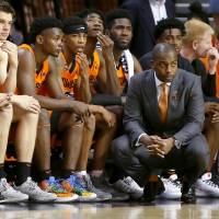 Oklahoma State coach Mike Boynton watches during an NCAA basketball game between the Oklahoma State University Cowboys (OSU) and the Oral Roberts...