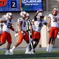 The Oklahoma State defense celebrates the fourth-down sack by  Kolby Harvell-Peel (31) in the fourth quarter Saturday against Tulsa. [Sarah...