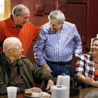 Ward 4 Councilman Pete White talks with Ron Millican, top left, Harry Wilson and Mariann Stone at one of his weekly get-togethers over lunchtime...