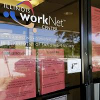 FILE - In this June 11, 2020, file photo, information signs are displayed at the closed Illinois Department of Employment Security WorkNet center...