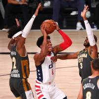 Aug 9, 2020; Lake Buena Vista, Florida, USA;  Washington Wizards forward Rui Hachimura (8) drives against Oklahoma City Thunder guard Shai...