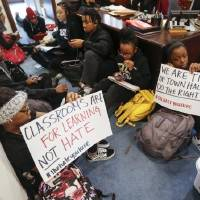 OU students participate in a sit-in organized by the Black Emergency Response Team student group outside of the office of OU provost Kyle Harper...