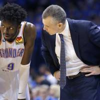 Oklahoma City coach Billy Donovan, right, talks with Jerami Grant during Game 4 of a first round playoff series against Porltand on April 21 at...