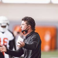 Oklahoma State coach Mike Gundy instructs players during Wednesday's practice, the first of the fall season. [Bruce Waterfield/OSU Athletics]