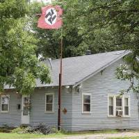 A man flying Nazi swastika flags was arrested Sunday morning after shooting a woman who stole one of the flags at his residence, 217 E. Cherokee in Hunter. The woman was transported to OU Medical Center in Oklahoma City where she was undergoing surgery for four bullet wounds. Cass Rains | Enid News & Eagle