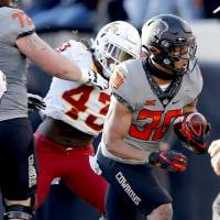 Oklahoma State's Chuba Hubbard (30) rushes during the college football game between the Oklahoma State University Cowboys and Iowa State Cyclones...