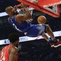 Chris Paul of the Oklahoma City Thunder dunks during the first half of the NBA All-Star basketball game Sunday, Feb. 16, 2020, in Chicago. (AP...