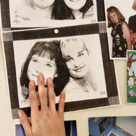 Celia Huntley touches a photo of her and her cousin, Jillian Riddle, who was killed in a...