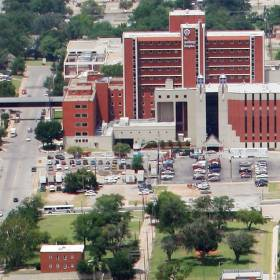 <p>St. Anthony Hospital was surrounded by blight and had no well defined entrance when this photo was taken in 2006 just before construction started on a $220 million makeover. [Oklahoman Archives Photo]</p>