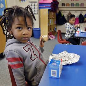 Highland Park Elementary pre-k student Derrion Goins eats breakfast in Midwest City.