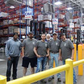 Warehouse supervisors pose in the Ben E. Keith warehouse. [Photo provided]