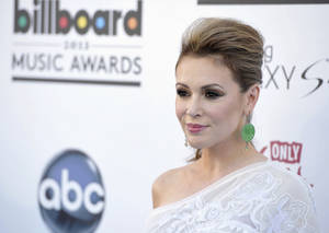 Alyssa Milano is pictured here on May 19, 2013 at the Billboard Music Awards at the MGM Grand Garden Arena in Las Vegas (Photo by John Shearer/Invision/Associated Press)