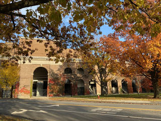 Dartmouth's Memorial Stadium, with red ivy growing up its brick facade. (Photo by Tricia Tramel)