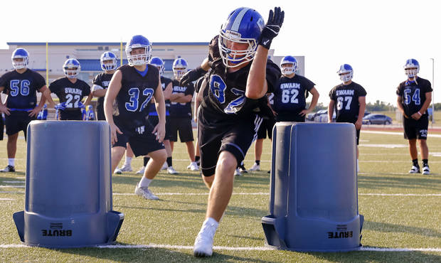 Players run through defensive line drills during the Deer Creek High School football practice in Edmond, Okla. on Wednesday, Aug. 10, 2016. Photo by Chris Landsberger, The Oklahoman