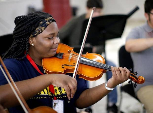 Amaury McCarer practices with El Sistema Oklahoma at First Presbyterian Church of Oklahoma City in Oklahoma City, Thursday, Sept. 19, 2019. She is a member of the program's new La Sala Musical ensemble, which will perform Saturday as part of the grand opening celebration for Scissortail Park. [Sarah Phipps/The Oklahoman]