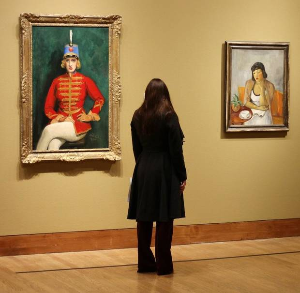 "A visitor looks at artworks in the Oklahoma City Museum of Art exhibit ""Renewing the American Spirit: the Art of the Great Depression"" Wednesday, October 30, 2019. [Doug Hoke/The Oklahoman]"