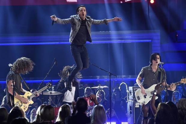 "Eric Steedly, from left, Brandon Lancaster and Chandler Baldwin, of Lanco, perform ""Rival"" at the 54th annual Academy of Country Music Awards at the MGM Grand Garden Arena on Sunday, April 7, 2019, in Las Vegas. [Photo by Chris Pizzello/Invision/AP]"
