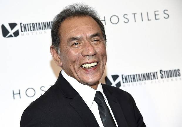 "In this Dec. 18, 2017 file photo, actor Wes Studi attends a special screening of ""Hostiles"" at Metrograph in New York. The Cherokee-American actor, groundbreaking filmmaker David Lynch and the first woman ever to receive an Academy Award nomination for directing, Lina Wertmuller, will be receiving honorary Oscars at the Governors Awards on Oct. 27, 2019 in Hollywood. [Photo by Evan Agostini/Invision/AP, File]"