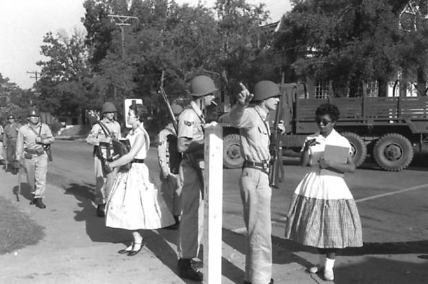 In September 1957, a white student passes through the Arkansas National Guard line as Elizabeth Eckford, one of the Little Rock Nine, is turned away. Later that month, President Dwight Eisenhower sent in U.S. Army troops, and they led Eckford and eight other black students into Central High School. PHOTO BY WILL COUNTS / ARKANSAS DEMOCRAT-GAZETTE