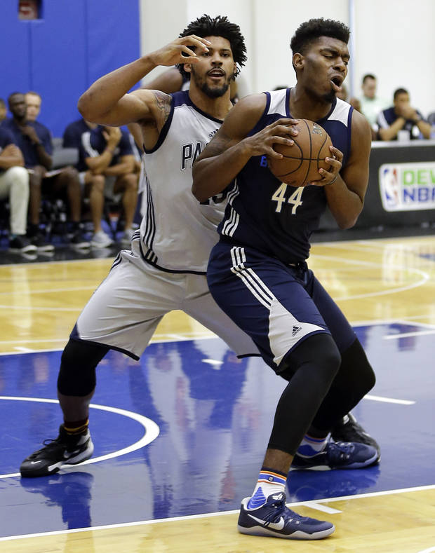 Dakari Johnson, right, played for the Thunder's Summer League team this month in Orlando. [AP PHOTO]