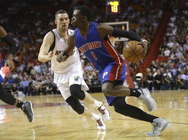 Detroit Pistons' Reggie Jackson (1) drives to the basket as Miami Heat's Beno Udrih defends during the first half of an NBA basketball game, Tuesday, Dec. 22, 2015, in Miami. (AP Photo/Lynne Sladky)