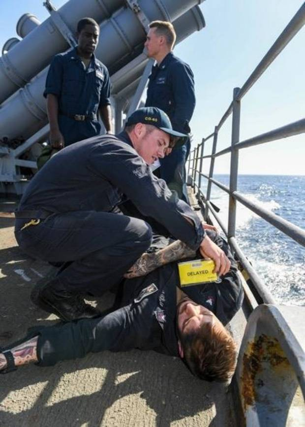 Choctaw sailor participates in simulated casualty drill aboard USS Normandy