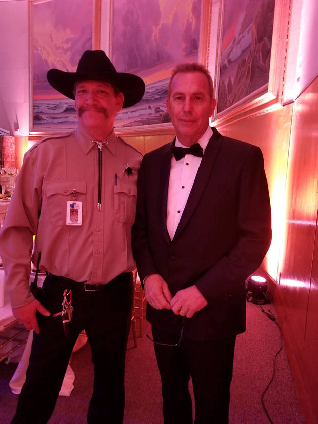 From left, Tim, the head of security and new social media star for the National Cowboy & Western Heritage Museum, and Kevin Costner pose for a photo at the 2019 Western Heritage Awards at the museum. [Photo provided]