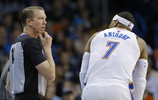 Oklahoma City's Carmelo Anthony (7) talks with referee Ed Malloy (14) during the NBA basketball game between the Oklahoma City Thunder and the Portland Trailblazer at Chesapeake Energy Arena, Tuesday, Jan. 9, 2018. Photo by Sarah Phipps, The Oklahoman
